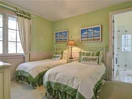 Guest bedroom for younger guests features two twin beds.