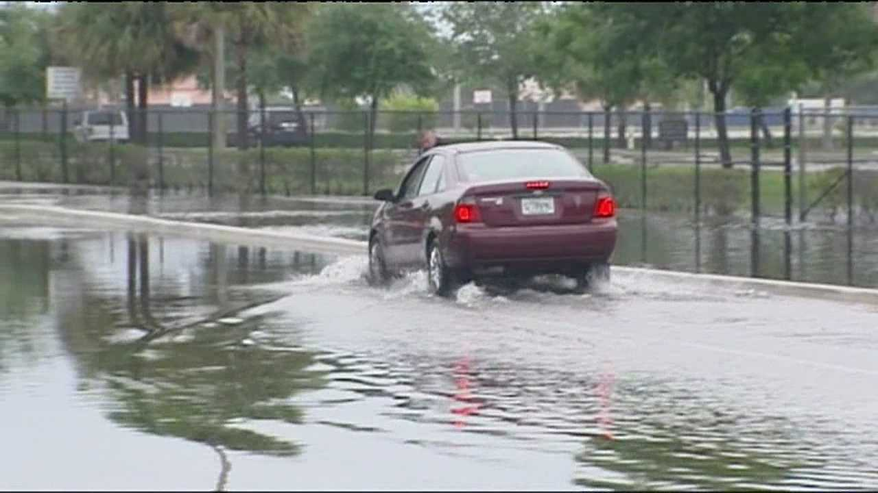 img-Impatient motorists risk driving through high water