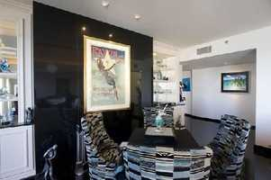 The penthouse's open floor plan features an artistic dining nook.