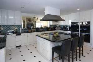 Gourmet kitchen, butler's pantry, custom cabinetry, granite counter tops, & 2 Sub-Zero refrigerators/freezers.