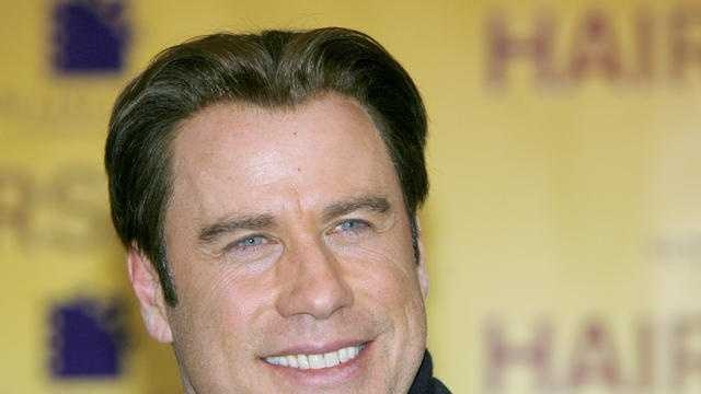 "John Travolta is giving his neighbors in Marion County free tickets to his new movie ""Killing Season."""