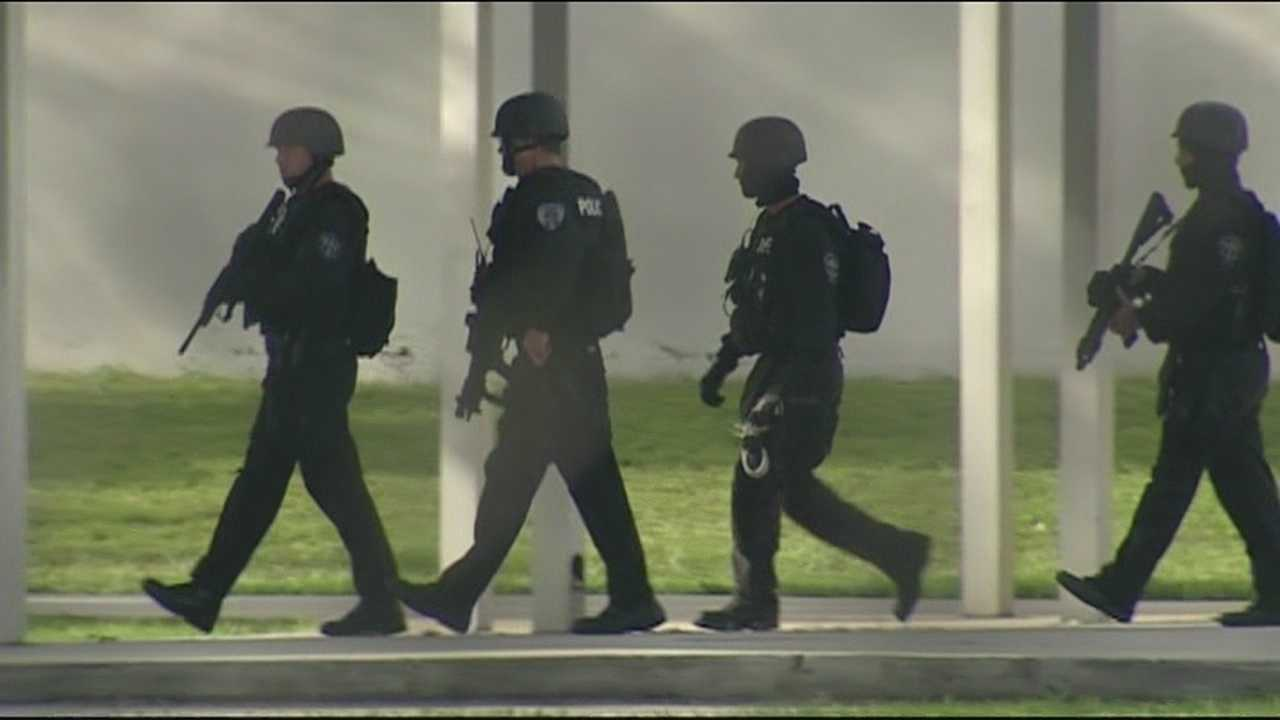 The SWAT team inspects every building at the Dreyfoos School of the Arts after 2 people were found dead on campus.