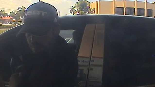 Police say this surveillance image from an ATM shows one of the gunmen making a cash withdraw.