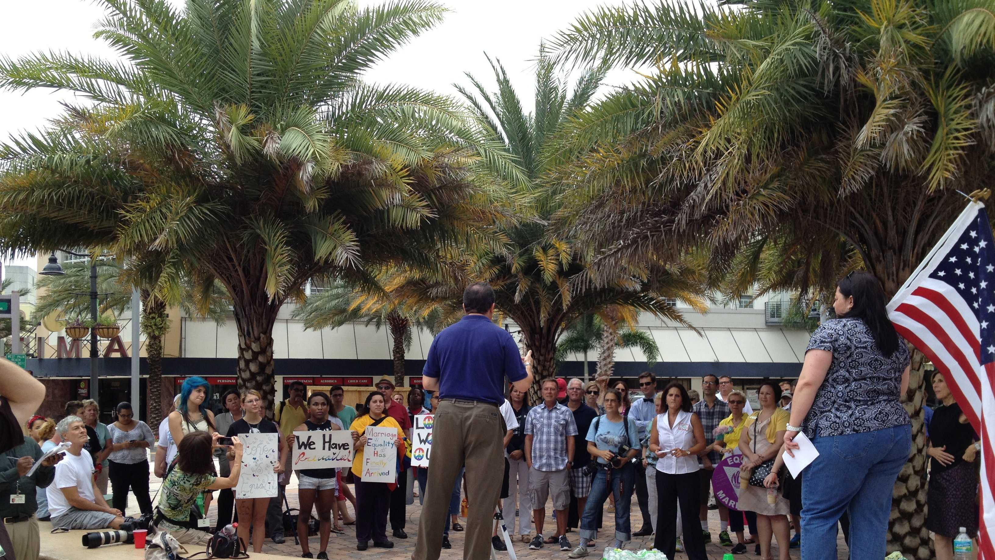 About 50 people gather in support of same-sex marriage during a rally in downtown West Palm Beach.