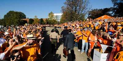 Many schools have a pregame walk in which fans make a tunnel and exchange high-fives with the players, but few are as colorful as the Vol Walk at Tennessee.