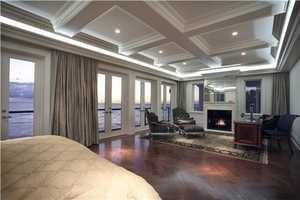 The master bedroom is just as spacious as it is glamorous. It features beautiful ceilings, sprawling balconies, and a generous sitting space. Amazingly, this is just one of 8 bedrooms the home has to offer.