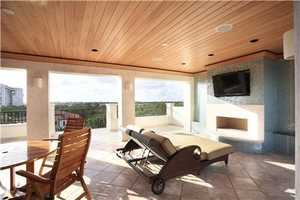 Outdoor entertaining is staged as an unforgettable on the spectacular sky deck opening off the top-floor club room.
