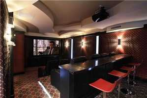 State of the art home theater and bar.