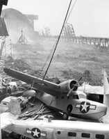 1945: A hurricane damages planes at Richmond Naval Air Station.