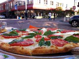 We asked, and you answered. Take a look at the area's 25 best pizza joints, as voted on by our Facebook fans.