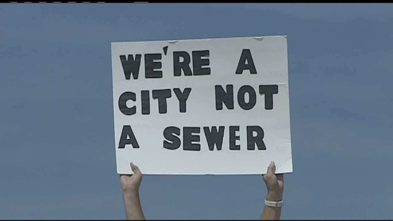 'We're a city not a sewer' sign