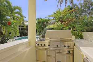 Summer kitchen features a complete grilling station.