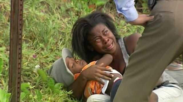 A toddler, a teenager and five adults -- all from Haiti -- were taken into custody Wednesday after being dropped off by a boat on Palm Beach.