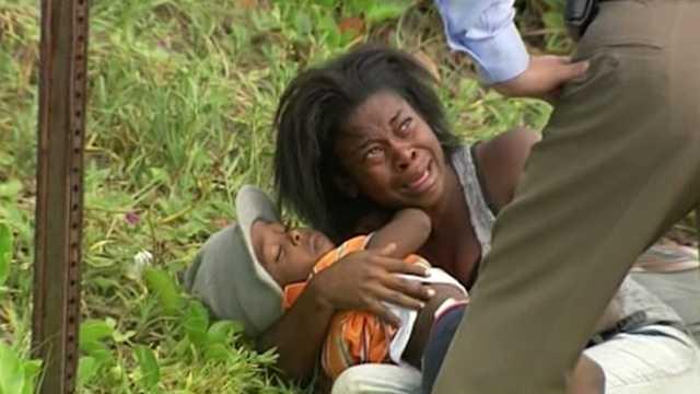 img-Toddler among Haitian migrants taken into custody