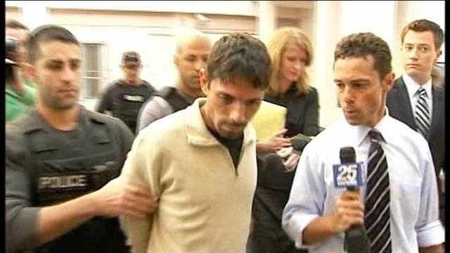 Eduardo Antonanzas is led away in handcuffs after his arrest in 2011.