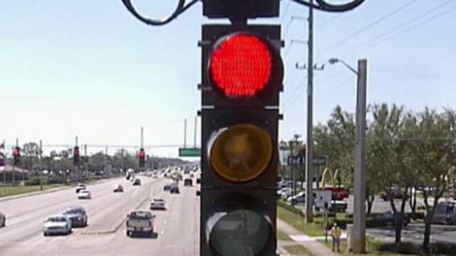 """Red-light cameras in Florida are just """"backdoor tax increases,"""" according to one senator."""