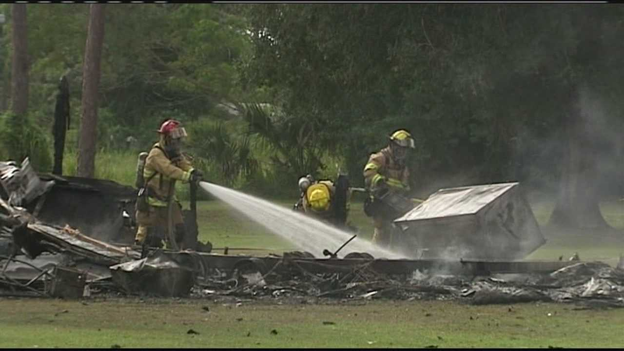 Firefighters douse remnants of mobile home