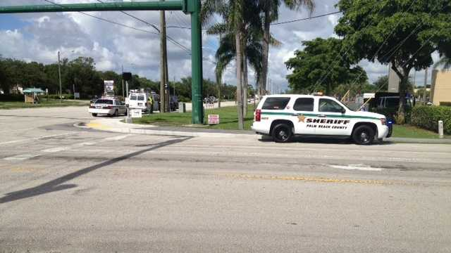 A father and child were struck by a van while crossing a Lake Worth road.