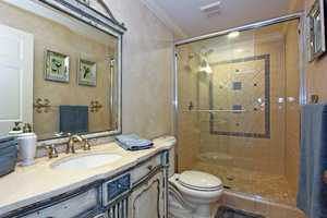 Guest bathroom features a very large shower.