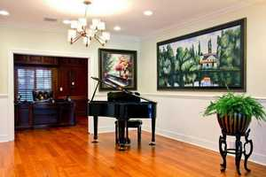The hallway outside of the office provides an elegant space for art and music.