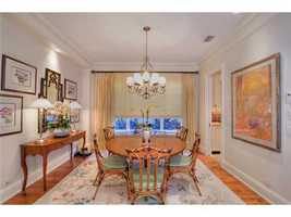 Hardwood floors add warmth to this traditional dining room.