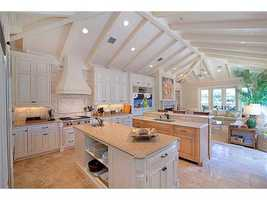 An expansive kitchen that is ideal for entertaining highlights the very finest appliances such as Wolf, Sub-Zero, etc.