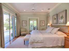 First floor master suite features cheerful, yet calming Old Florida design.