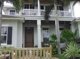 The second story features a beautiful balcony on the front and back of the home.