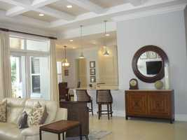 The kitchen features a dining nook and bar seating for casual dining.
