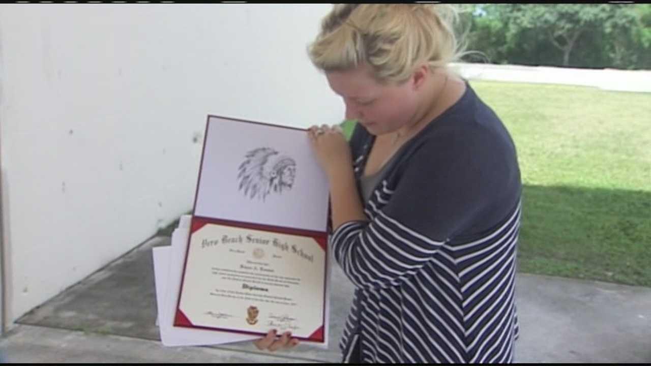 Kaycee Lonstad holds diploma