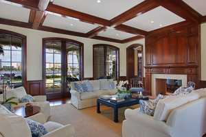 Sit comfortably in this living room under the beautifully beamed ceilings, looking out over the ocean view.