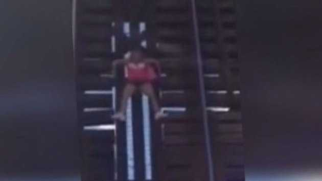 A woman was dangling from a Fort Lauderdale railroad bridge until firefighters rescued her.