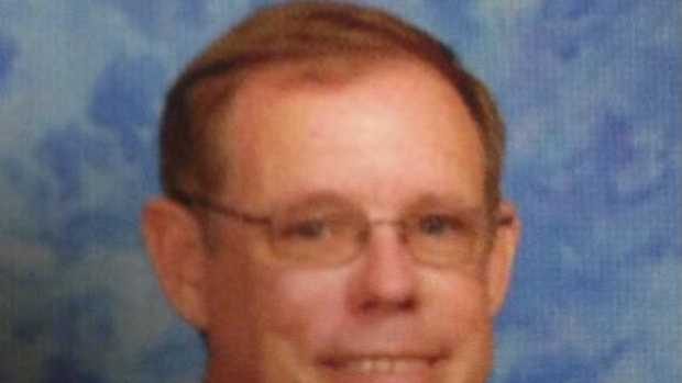 Science teacher Greg Sims has been suspended without pay for taping a disruptive student's hands together, school officials say.