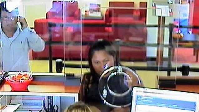 Detectives are trying to identify the man on the far left who they say forced a woman into his car at gunpoint and forced her to withdraw thousands of dollars from her bank.