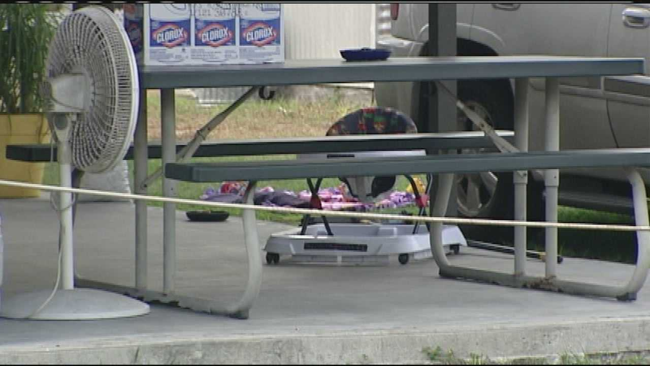 A man accidentally runs over his 7-month-old granddaughter, unaware that she was on a blanket in the yard.
