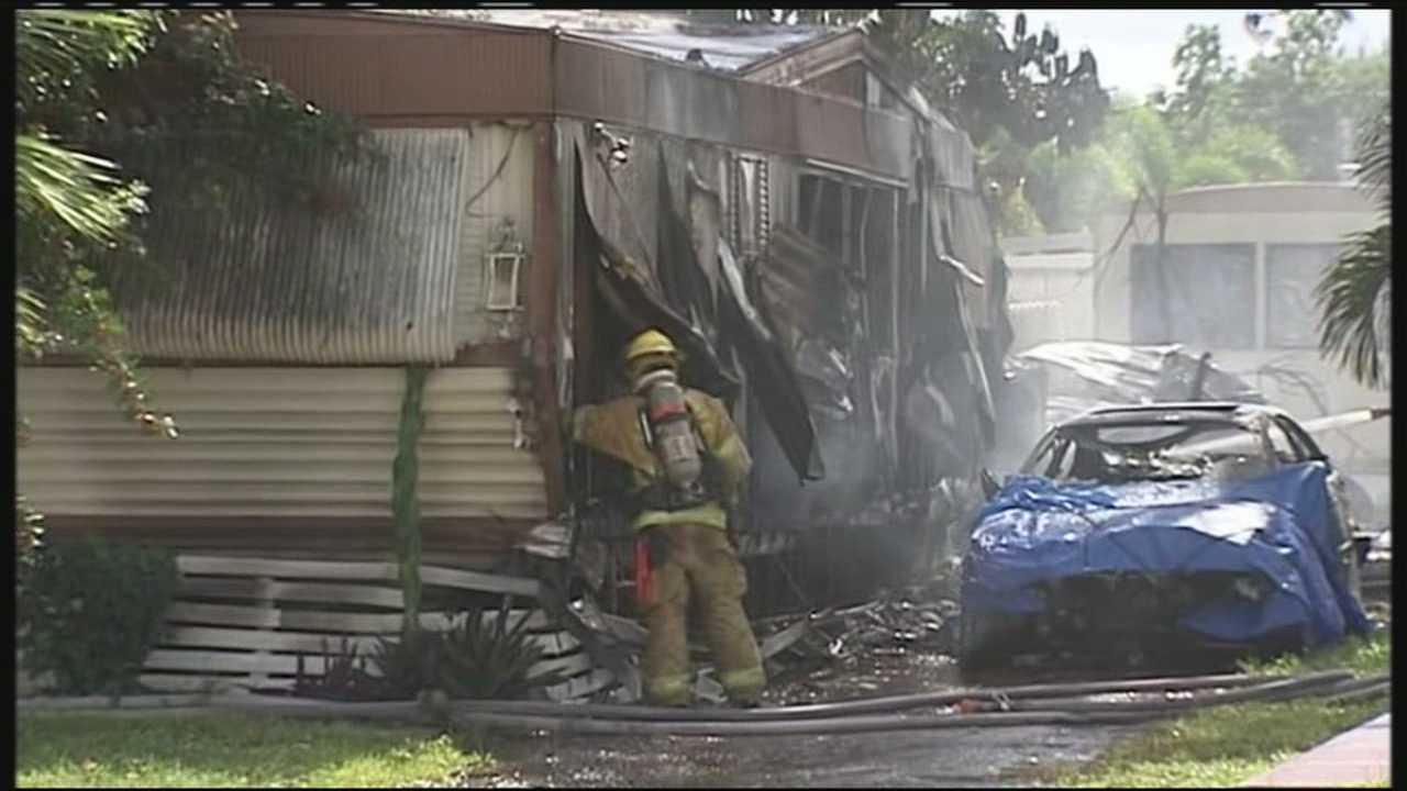 Firefighters battled more than just flames after a fire spread from one mobile home to another Friday in Greenacres.