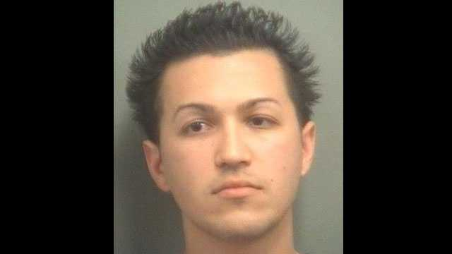 Amir Talebzadeh is accused of racing moments before a crash that killed a woman.