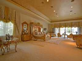 The master bedroom is done in the style and grandeur of one of the finest Presidential suites.
