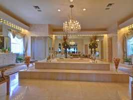 Unbelievable master bathroom, features a massive, eye-catching spa tub.
