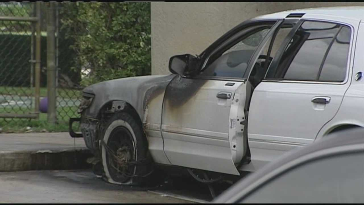 A car catches fire in a KinderCare parking lot in West Palm Beach.