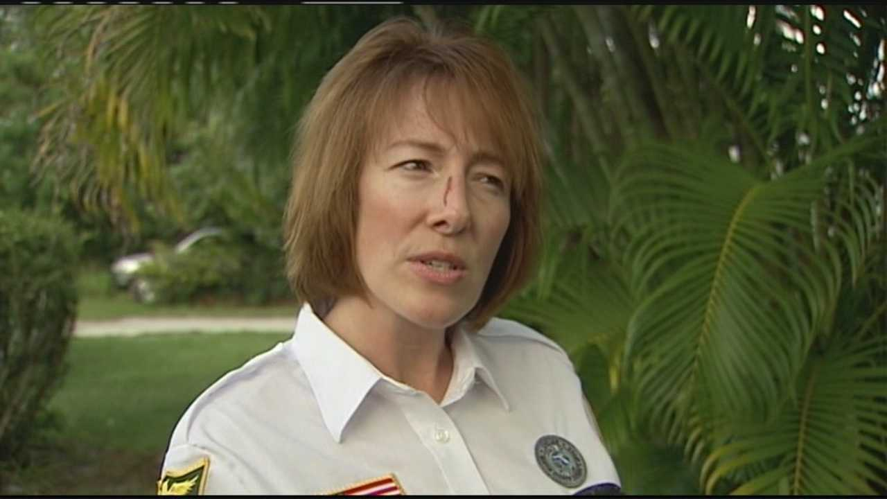 Martin County crossing guard Joan Hoffpaiur was attacked by a pit bull while walking two girls and their mother across the street.