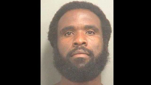 Willie Anderson is accused of watching a woman use the bathroom at the Palm Beach County Health Department.