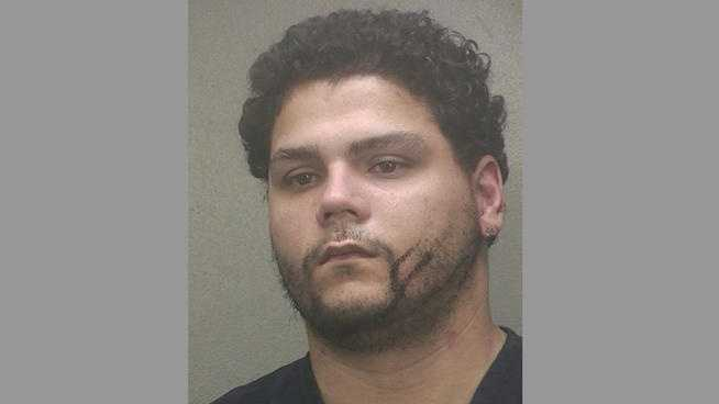 Raul Serrano is accused of killing Lacy Woolridge, whose body was found on the side of the road in Dania Beach.