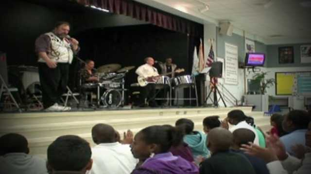 Image Underprivileged kids learn about orchestra music through Palm Beach POPS program