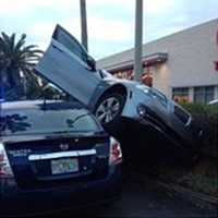 The driver of the car told deputies that the parking assist on the car malfunctioned while parking.