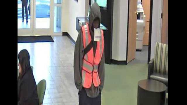 Bank robber wearing safety vest