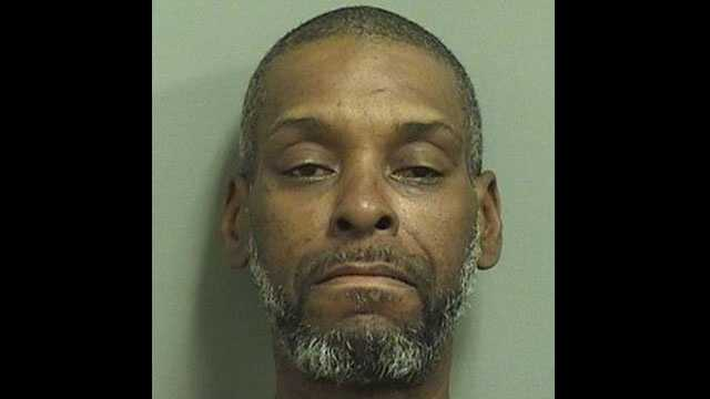 Daryl Lewis is accused of attacking a woman outside a CVS pharmacy in Boca Raton.