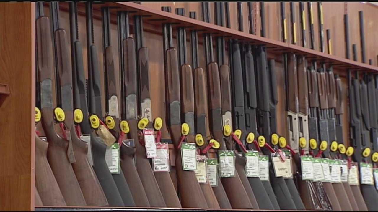 Shotguns and rifles on rack