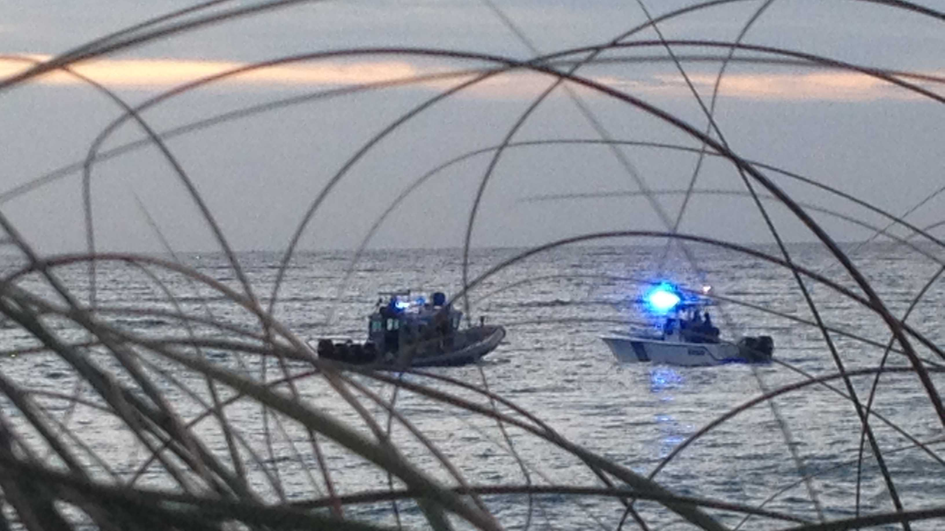 Authorities search for a missing swimmer in the Boynton Beach inlet.