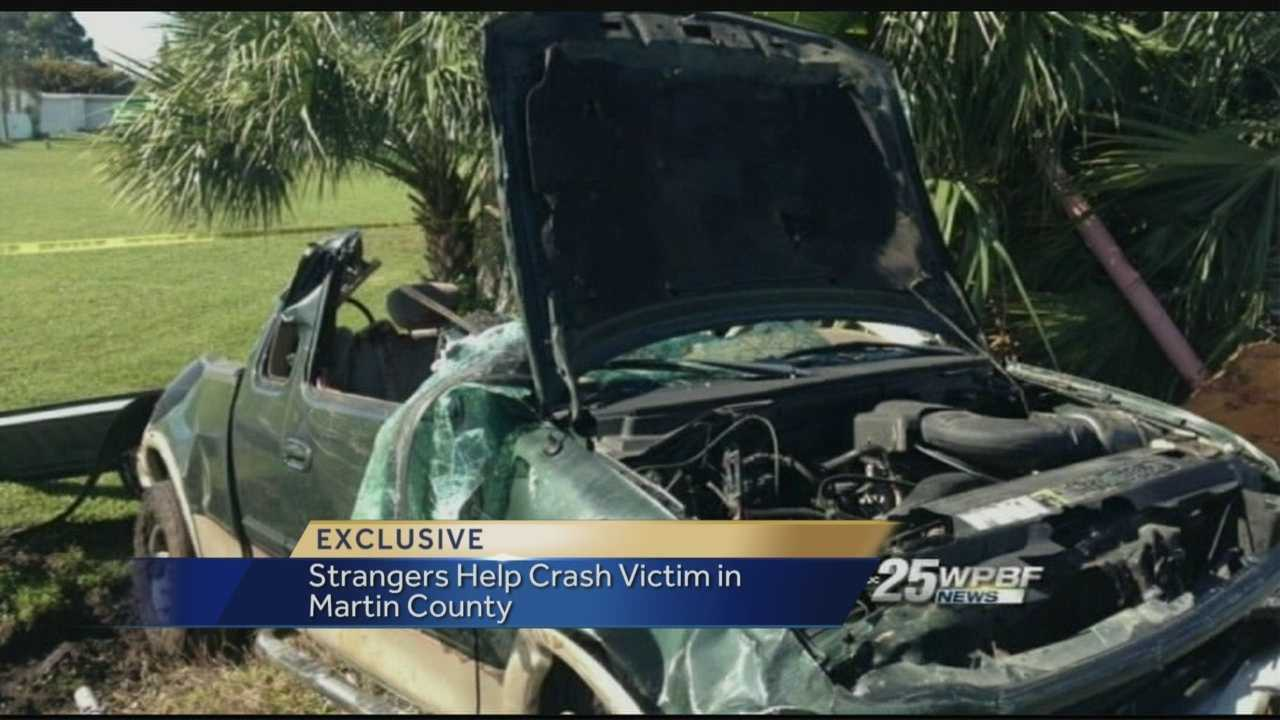 Bystanders had to jump into action after a motorist crashed his pickup truck just outside of a marine sales facility.